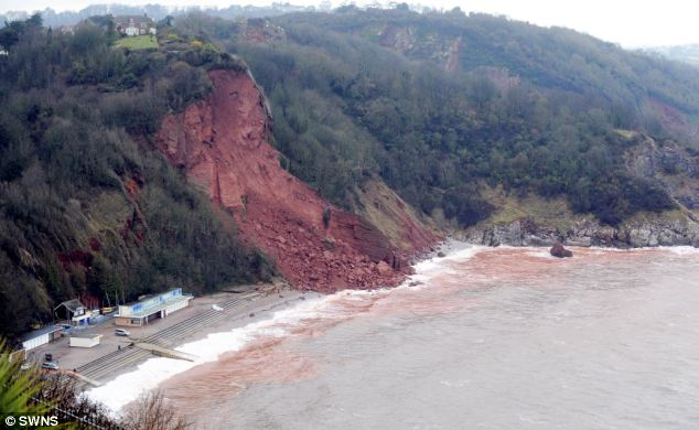 The scene at Oddicombe Beach, Torquay, where a huge chuck of retired police officer Sue Diamond's garden fell away from the cliff, six days after the house had been sold