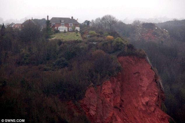 On the brink: Ridgemont House in Torquay where a huge chuck of the garden fell away from the cliff, six days after the house had been sold