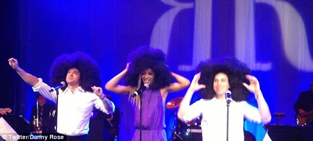 Celebrity friends: The married couple put on Afros to belt out a song with singer Ciara at their Paramount Studios reception