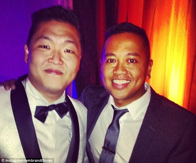 Man of the moment: One guest meets 'Gangnam Style' South Korean rapper Psy (left) who performed at the couple's wedding at 1am