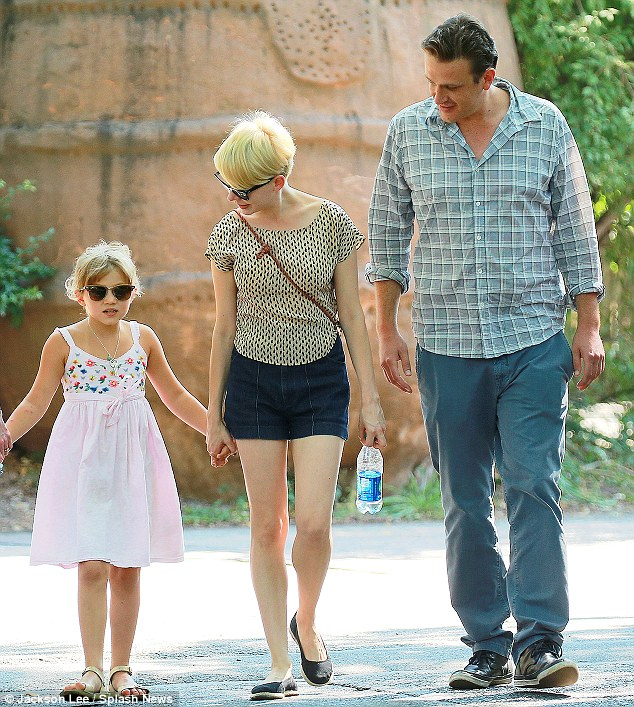 Former flame: Michelle, daughter Matilda and ex-boyfriend Jason Segel are shown at the Bronx Zoo last August