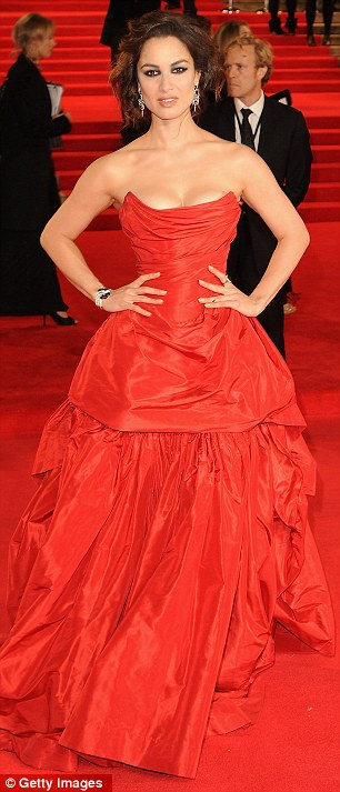 Ravishing in red: Berenice decided to match the red carpet as she showed off her perfect physique in her stand-out gown