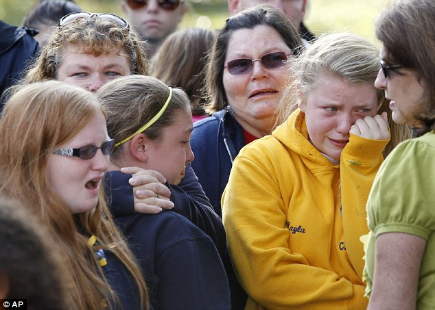 Grief: People weep at the gathering outside town hall earlier today as authorities revealed they believed they had found Autumn's body