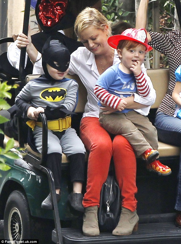 Getting in the spirit: Amy Poehler dresses up her young sons Archie and Abel for the costume party in Los Angeles