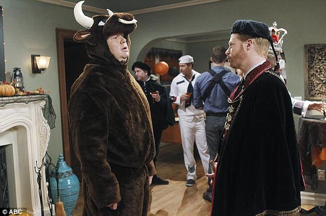 Festive attire: Eric Stonestreet and Jesse Tyler Ferguson's characters also dress up for the party