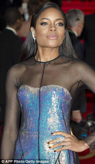 Scarlet woman: Berenice looked ravishing in red and co-star Naomie Harris sparked in blue sequins