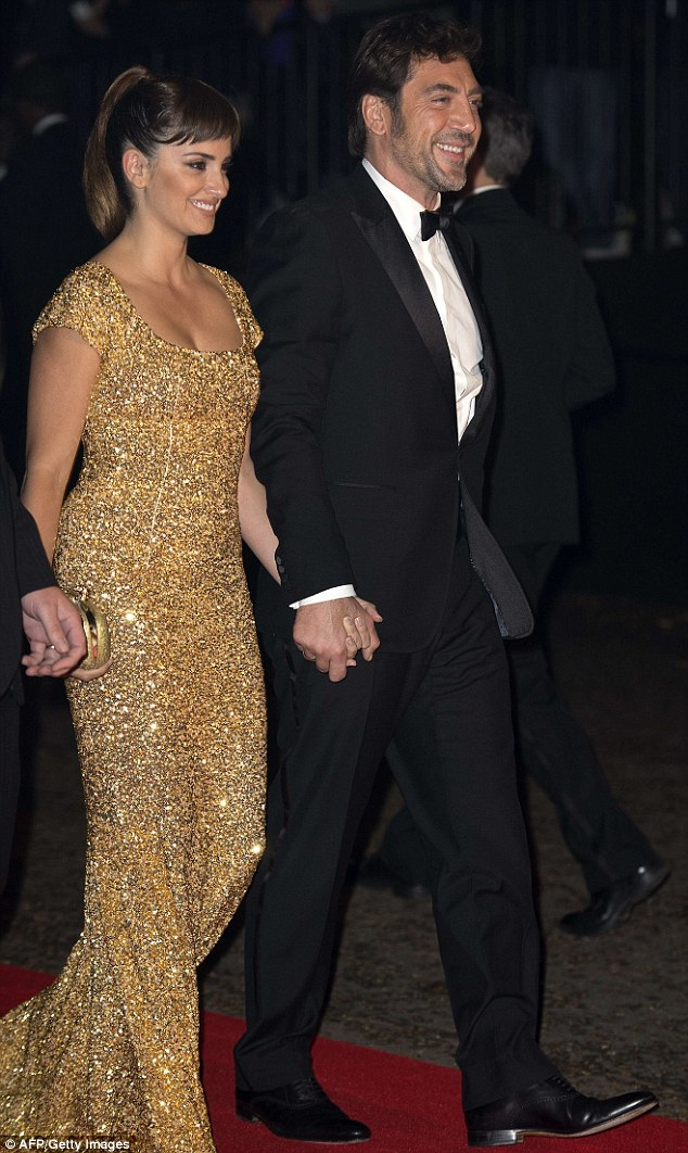 Suited and booted: Javier attended the afterparty with wife Penelope Cruz