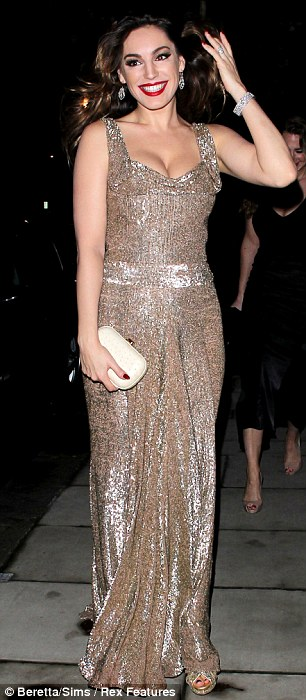Absolutely gorgeous: Kelly re-emerged in a floor length gown which showed off her ample assets, and teamed it with a Alexandra DeClaris clutch bag