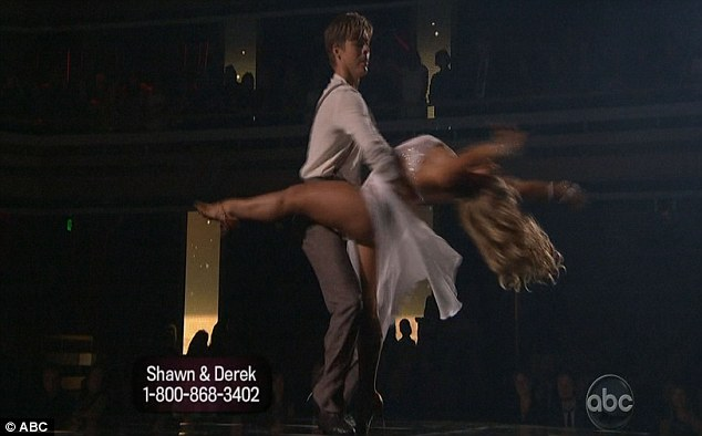 Dramatic: Derek Hough and Shawn Johnson's rumba wowed the audience but attracted mixed reviews from the judges