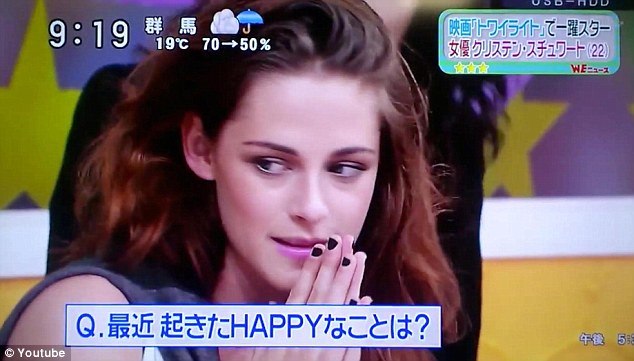 Feeling awkward? Kristen doesn't seem comfortable as she appears on an early morning Japanese show on Wednesday