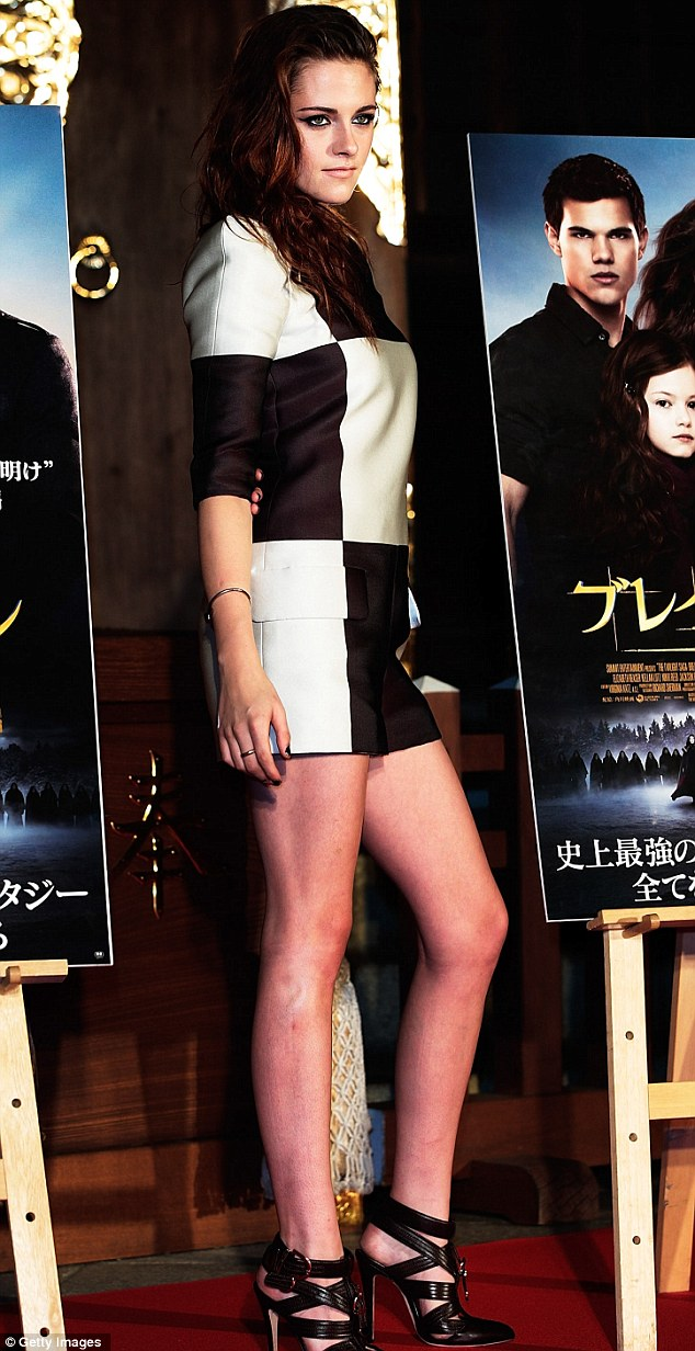 Strutting her stuff: Kristen didn't hold back as she showcased her incredible figure in a tiny minidress
