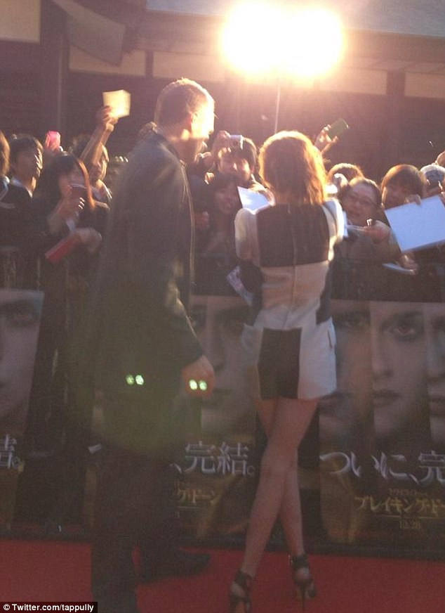 Chatting to fans: Kristen takes time out to sign autographs for her fans on the red carpet