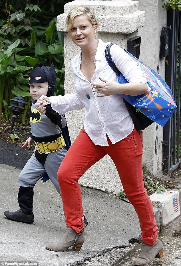 Dressed down chic: The comedy actress holds her young son's hand as she drops him off at the Beverly Hills Halloween party