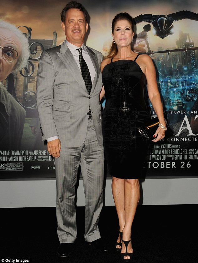 Happy couple: Tom arrived with wife Rita Wilson on his arm to promote the hotly anticipated movie