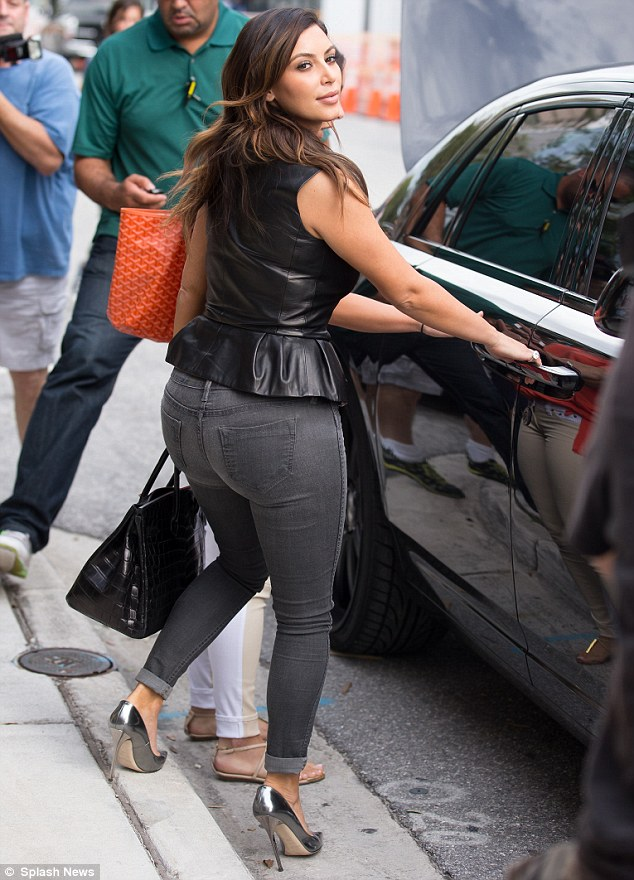 Hot to trot: Kim pops her curvy derriere into her car
