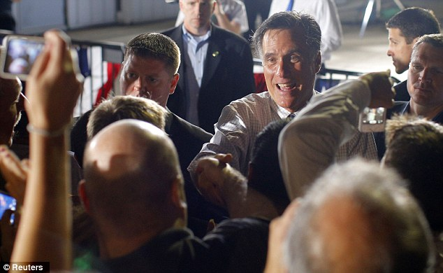 Meet and greet: Republican presidential nominee Mitt Romney greets audience members at a campaign rally at the airport in Cedar Rapids, Iowa, yesterday