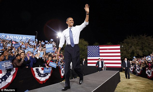 Grand entrance: President Obama waves to supporters as he arrives for a campaign rally in Las Vegas, Nevada