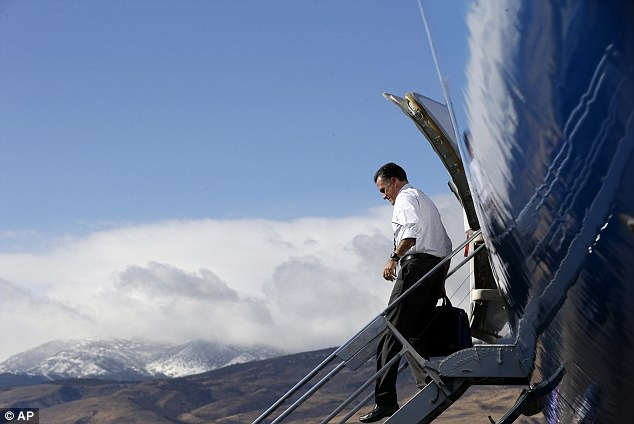 Backing: Donald Trump is a supporter of Mitt Romney, seen here with the Reno Mountains in the background as he arrives at Reno-Tahoe International Airport in Reno, Nevada, yesterday before traveling to a campaign rally