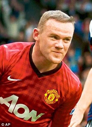 Good hair: The Manchester United footballer has a full mane that he often styles now