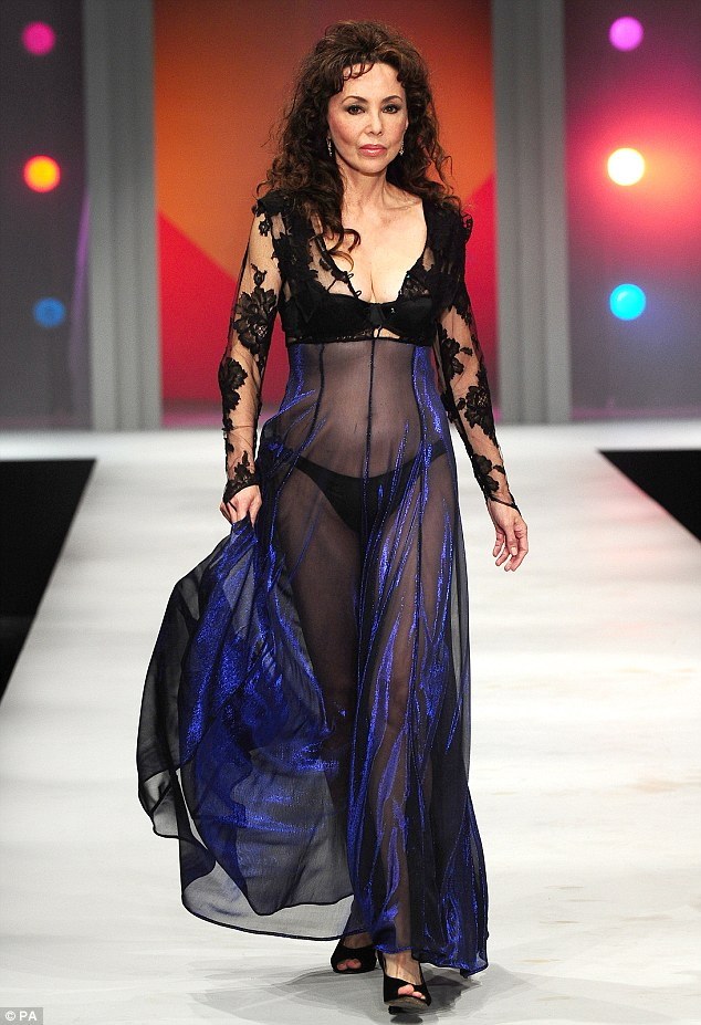 Catwalk queen: Marie defied her age by wearing a black bra and knickers with a navy sheer dress