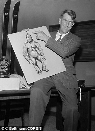 Sir Edmund Hillary, (left) conqueror of Mount Everest, shows newsmen here a 1/27 scale of an Abominable Snowman or Yeti, which he hoped to capture on the next expedition to the Himalayas. He did not