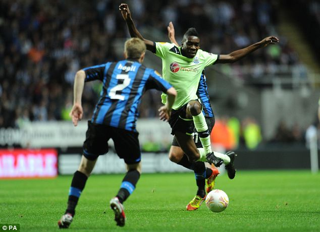 Going over: Sammy Ameobie is fouled by Bruges' Jonathan Blondel