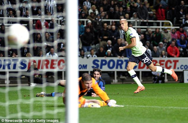 Gabriel Obertan (R) of Newcastle United scores the opening goal