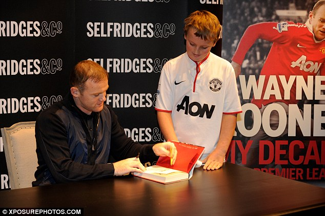 Read all about it: Wayne Rooney launched his new book at the Trafford Centre in Manchester on Thursday