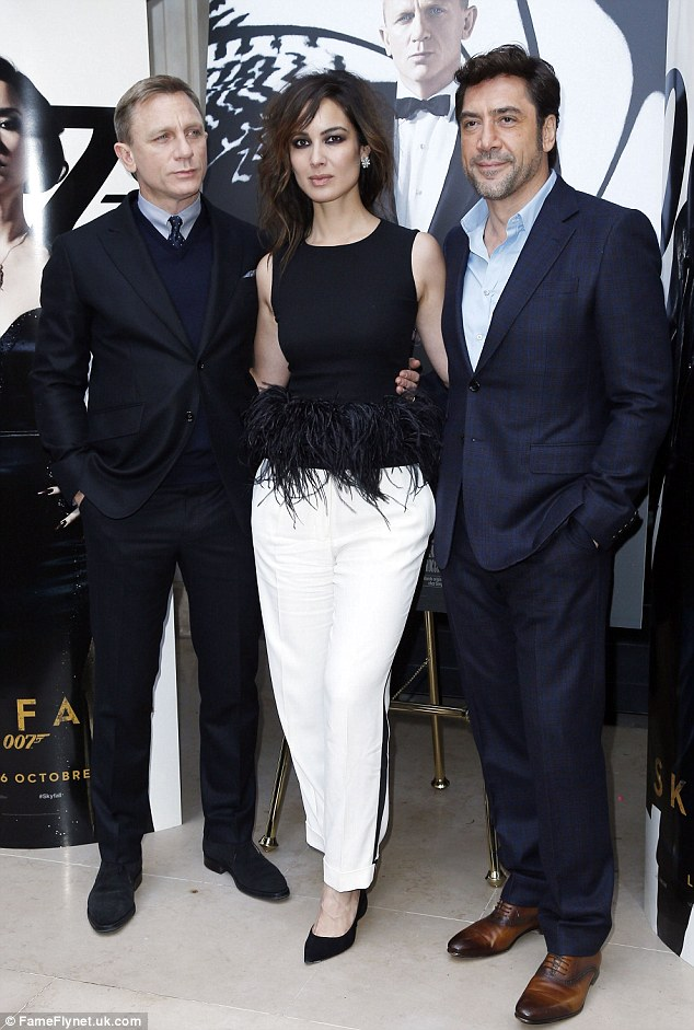 Success: Daniel, seen posing with Skyfall co-stars Berenice Marlohe and Javier Bardem, is pleased with the public interest the movie has already received