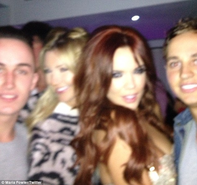 With her raving buddies: The former TOWIE starlet also uploaded a picture as she took to the dancefloor with Lineker and some others