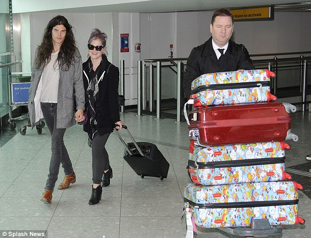 Anything to declare: Kelly Osbourne and boyfriend Matthew Mosshart arrived at Heathrow Airport with lots of luggage cases