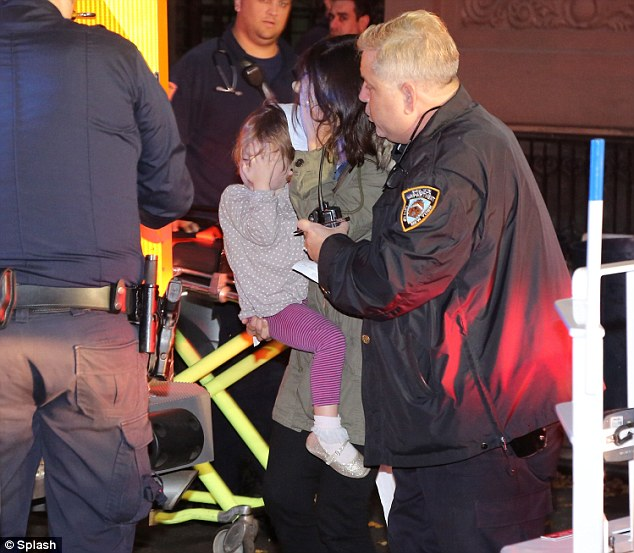 Discovery: Marina Krim holds onto her daughter, three-year-old Nessie, after finding her two other children, two-year-old Leo and six-year-old Lulu, stabbed to death allegedly by their nanny