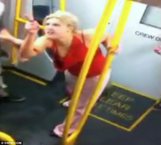 Abusive: The young blonde is seen swearing, spitting and hitting other passengers on the Sydney train
