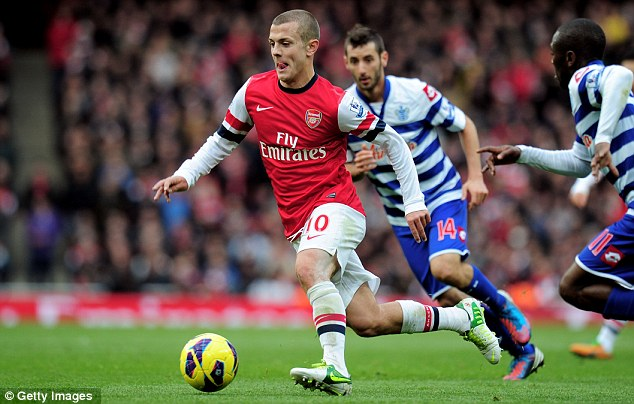 Good to be back: Jack Wilshere takes on QPR after returning to the Arsenal line-up