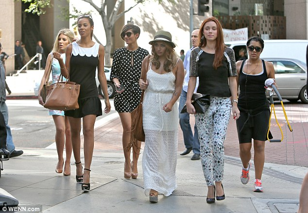 Walk this way: The girls looked like they had walked straight off the set of a music video as they headed for lunch