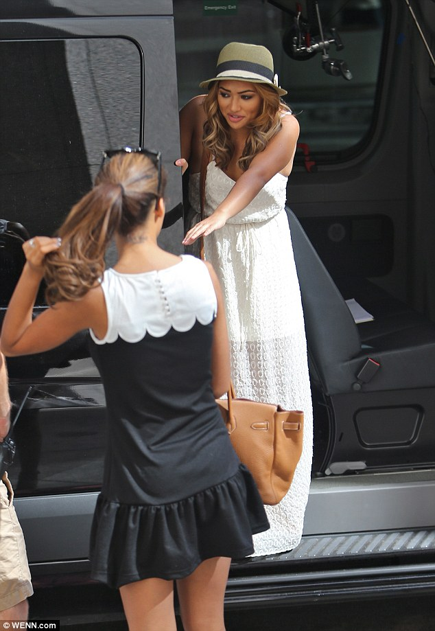 Long way down: Rochelle watched on as Vanessa struggled to get out of the bands van