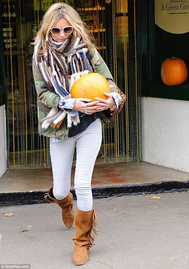 Getting into the spirit of things: Kate goes pumpkin shopping on Friday ahead of Halloween next week