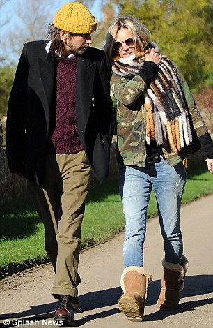Standing by her side: Kate Moss walks by the side of friend Bobby Gillespie
