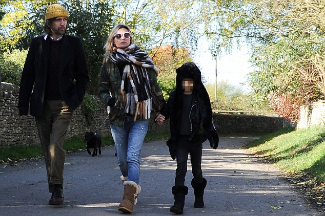 Fun day out: Kate is accompanied by Scottish musician Bobby Gillespie as she takes daughter Lila Grace to visit a farmhouse in Oxfordshire