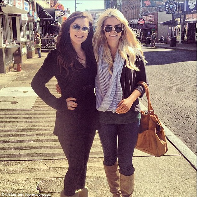 Brave: Lauren Scruggs, right, posing with her prosthetic left on display while out and about in Texas