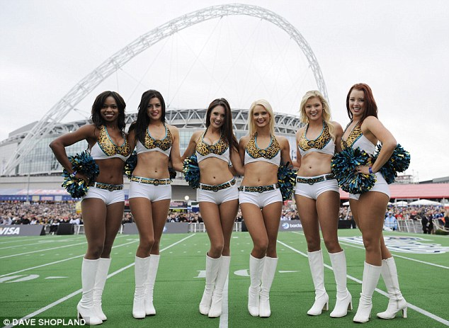Braving the cold: Cheerleaders strut their stuff ahead of the Wembley clash