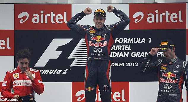 Main man: Sebastian Vettel (centre) celebrates winning the Indian Grand Prix