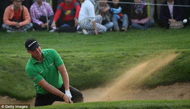 Marching on: Hanson held his nerve on the final day to maintain his lead in Shanghai
