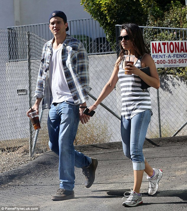 Loved up: Ashton and Mila went public with their romance in September after months of dating speculation