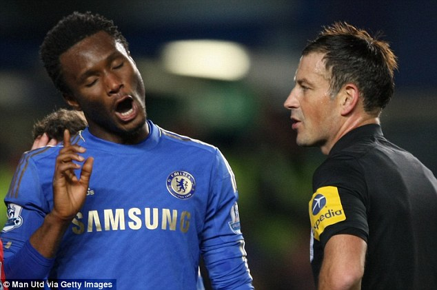 Dispute: Mikel complains to Clattenburg as his side slump to defeat at Stamford Bridge