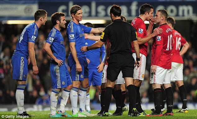 Fernando Torres of Chelsea talks to referee Mark Clattenburg
