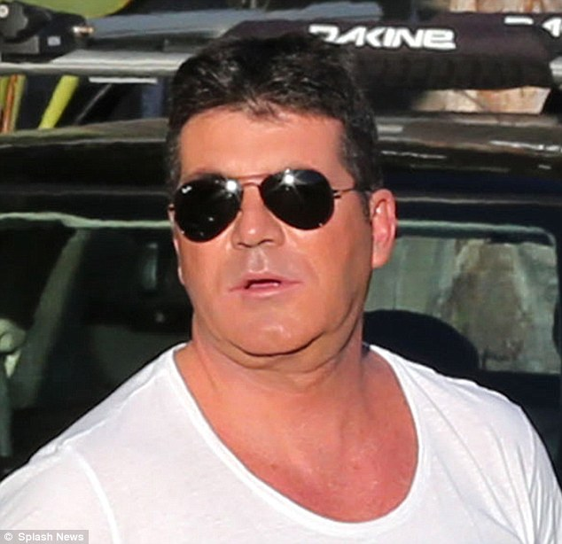 Larger than life: Simon Cowell shows off a heavy double chin in LA at the weekend