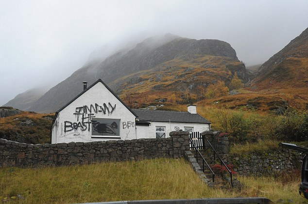 Target: Jimmy Savile's Highland cottage has been targeted by vandals, with black graffiti spray-painted across the outside
