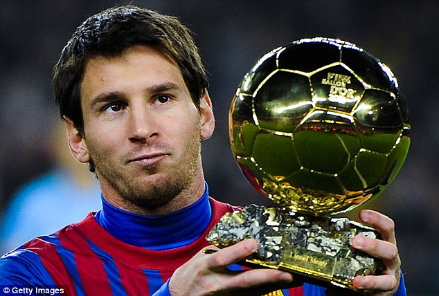 Familiar: Lionel Messi with the Ballon D'Or last year