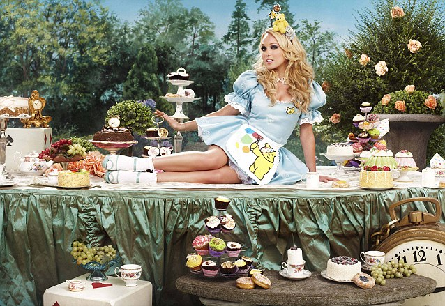 Jorgie Porter looks stunning as a cheeky Alice in Wonderland lying across the tea table sporting a Pudsey apron and hat